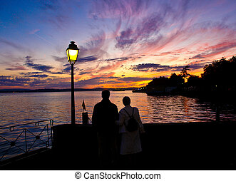 Romantic couple watching the sunset
