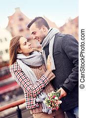 Romantic couple with flowers on a walk