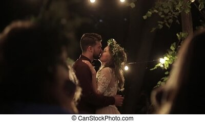 Romantic dance newlyweds lights - Guests looking beautiful...