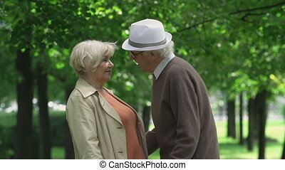 Romantic Date - Close up of elderly couple kissing and...