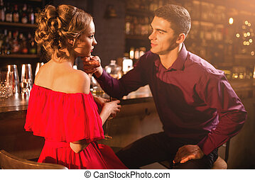 Romantic date in restaurant, couple at bar counter