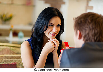 Romantic date - marriage proposal, man give ring to his girl...