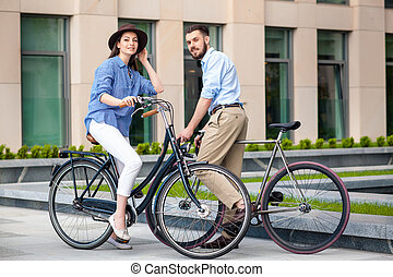 Romantic date of young couple on bicycles