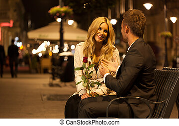 Romantic date on a bench - A man and his beutiful date ...