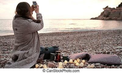 Romantic date on sea coast, beautiful sunset landscape.