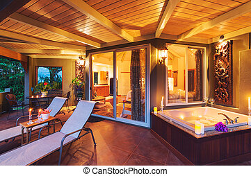 Romantic Deck on Tropical Home with Bathtub and Candles