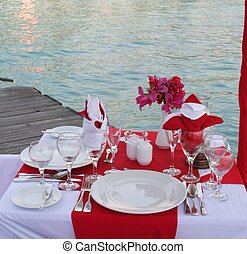 Romantic Dinner - A table set for a romantic dinner on a...