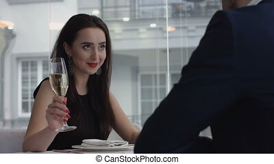 Romantic Dinner. Closeup Of Beautiful Elegant Sexy Young Woman drinking Champagne Red Wine In Luxury Gourmet Restaurant. Happy Smiling Girl On A Date. Drink. Celebration.
