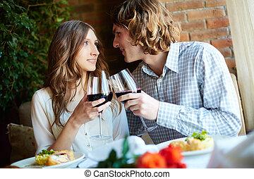 Romantic dinner - Young couple having romantic dinner in...