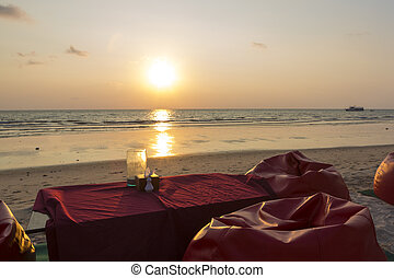 Romantic dinner with sunset, beach and ocean on Koh Chang Island.