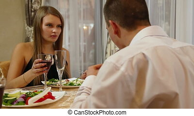 Romantic Fine Dining - Young beautiful couple having a...