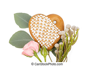Romantic gift: Ginger heart-shaped cookie with flowers isolated on white background