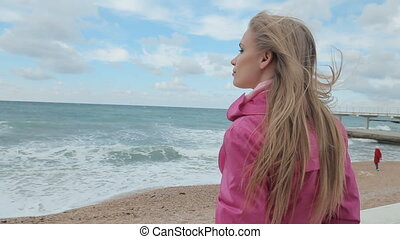 Romantic girl dreaming at sea coast