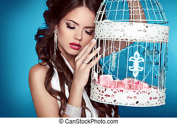 Romantic girl leaning against on Vintage bird cages with ...