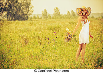 romantic girl - Romantic smiling young woman with a bouquet ...