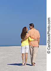 Romantic Happy Couple Walking on A Beach
