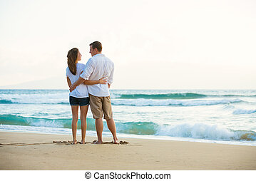 Young Couple on the Beach at Sunset
