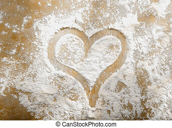 Romantic heart in sprinkled flour - Romantic heart hand...
