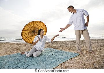 Hispanic couple together on beach