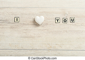 Romantic I Love You message on wood with a marble heart