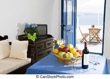 romantic interior of traditional cave house villa built into caldera cliff overlooking mediterranean sea in oia ia santorini greek islands greece