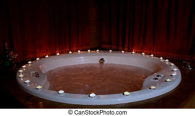 Romantic jacuzzi with candles