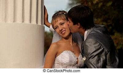 Romantic kiss under greek collon.