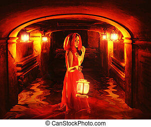 Romantic lady in red holding a lantern in a dark dungeon -...