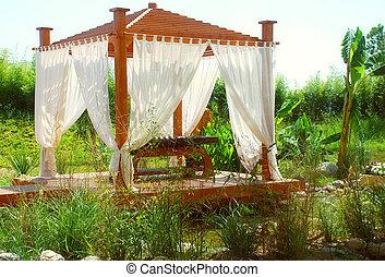 romantic landscape with wood summerhouse in east stile