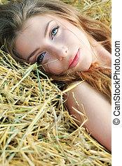 romantic look - Romantic young woman posing outdoor.