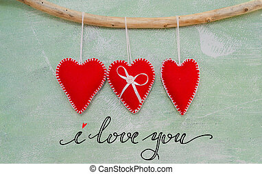 Romantic love composition of red felt hearts