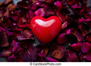 Romantic love - Image of big red heart surrounded by rose...