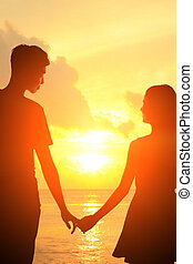 Romantic lovers in Maldives - silhouette of romantic lovers...