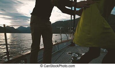 Romantic loving couple dancing on yacht sunset outdoors