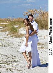 Romantic Man and Woman Couple Walking on An Empty Beach