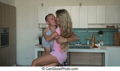 Romantic man carrying wife in his arms at home - Loving...
