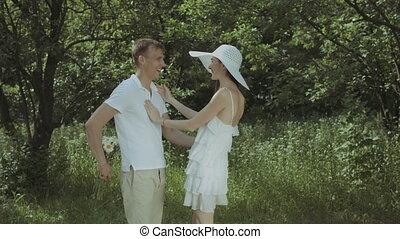 Romantic man giving flowers to his cute girlfriend