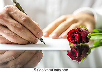 Romantic man writing a love letter