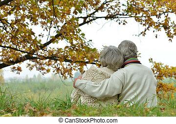 Romantic mature couple - Romantic mature couple is sitting...