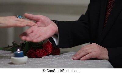 Romantic mature man kissing woman's hand