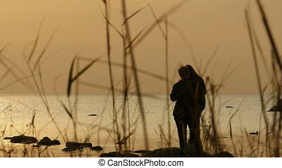 romantic meeting of young people by the sea