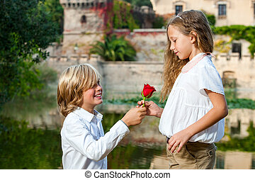 Romantic moment at lakeside. - Portrait of cute casanova boy...
