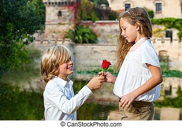 Romantic moment at lakeside. - Portrait of cute casanova boy...
