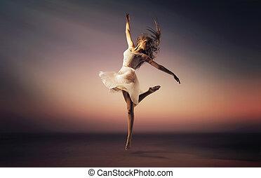 Romantic mood portrait of the jumping dancer