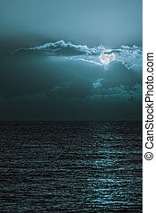 Romantic moonscape over tranquil sea. Turquoise blue moon sky.