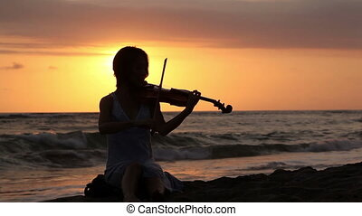 Romantic music - Silhouette of woman playing romantic music...
