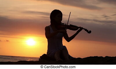 Romantic music - Violinist playing on violin romantic music...