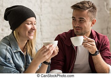 Romantic pair drinking coffee