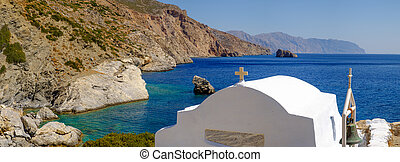 Romantic panorama view of beach with chapel, Greece