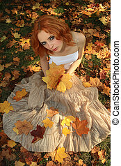 Romantic photo of a young woman in yellow leaves